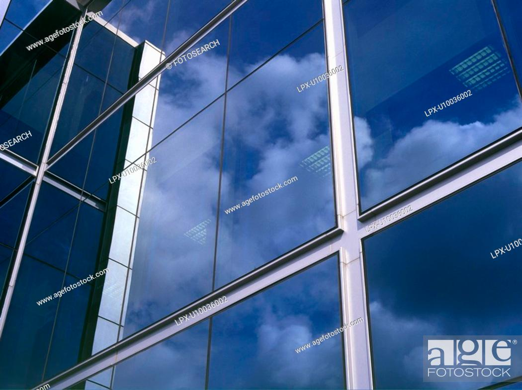 Stock Photo: Clouds reflecting in office block windows.