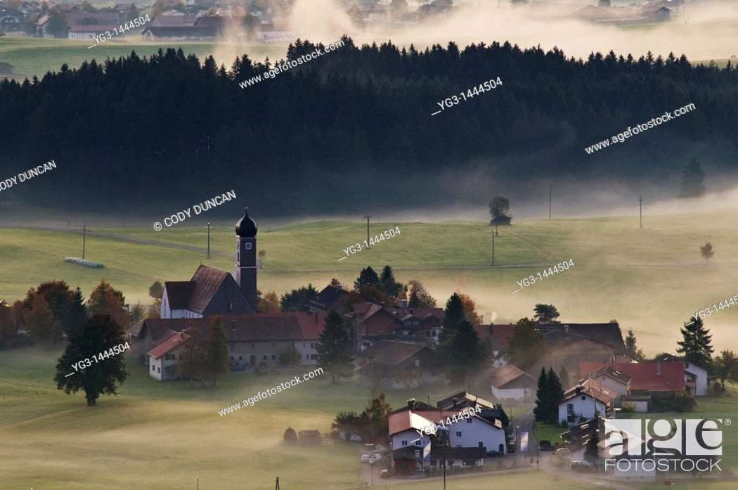 Stock Photo: Village of Speiden in the Allgaeu and clearing autumn mist, Bavaria, Germany.