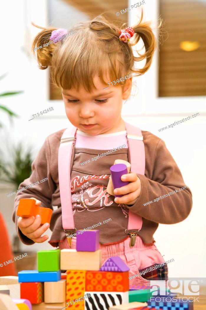 Stock Photo: Playful toddler girl.