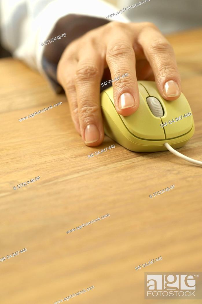Stock Photo: Woman's hand on computer mouse.