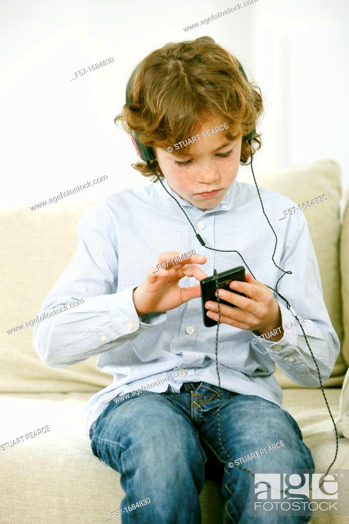 Photo de stock: Boy using smartphone.