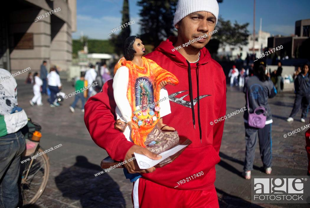 Stock Photo: A pilgrim holds an image of Saint Juan Diego at the pilgrimage to Our Lady of Guadalupe Basilica in Mexico City, Mexico, December 10, 2013.