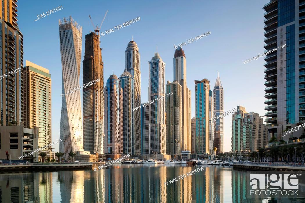 Stock Photo: UAE, Dubai, Dubai Marina, high rise buildings including the twisted Cayan Tower, morning.