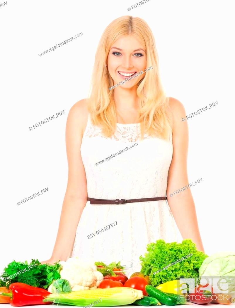 Stock Photo: Happy beautiful woman with fresh vegetables, isolated on white background.