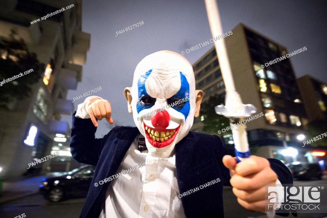Stock Photo - A reveller dressed as a  creepy clown  poses on Halloween  night in Hamburg a857220ccd25