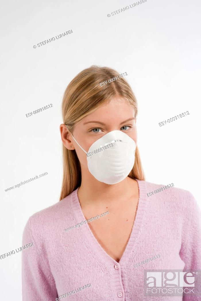 Stock Photo: Young woman with protecting mask.