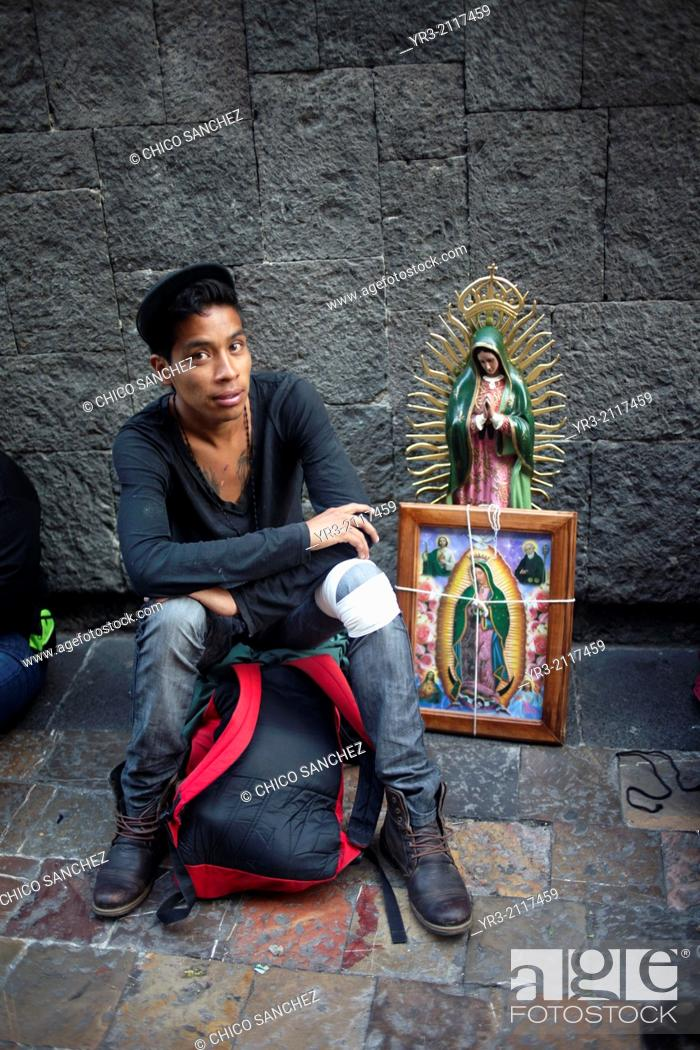 Stock Photo: Portrait of a teenage pilgrim at the pilgrimage to Our Lady of Guadalupe Basilica in Mexico City, Mexico, December 10, 2013.