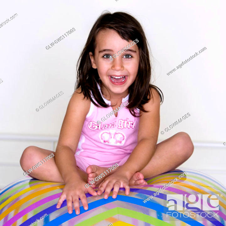 Stock Photo: Portrait of a girl sitting on an inflatable ball.