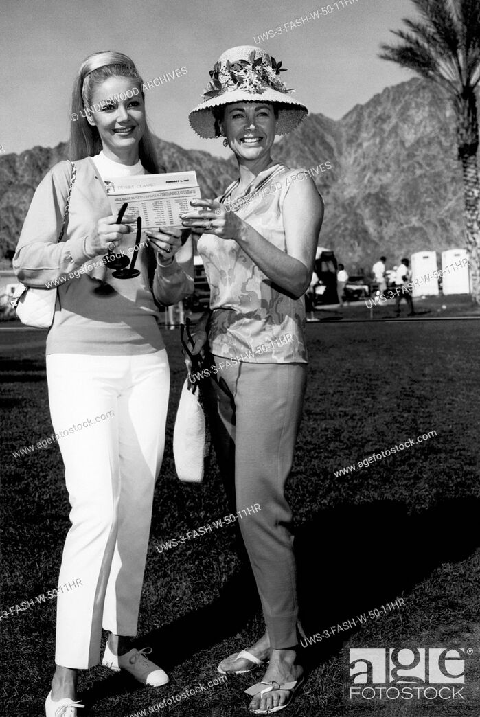 Stock Photo: Palm Springs, California: 1967 Two fashionable women at the Desert Classic Golf Tournament.