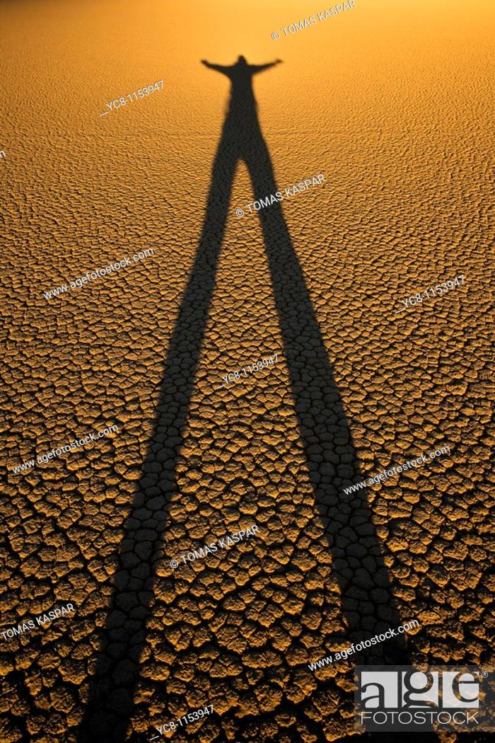 Stock Photo: Person shilouette at Racetrack playa Death Valley national park.