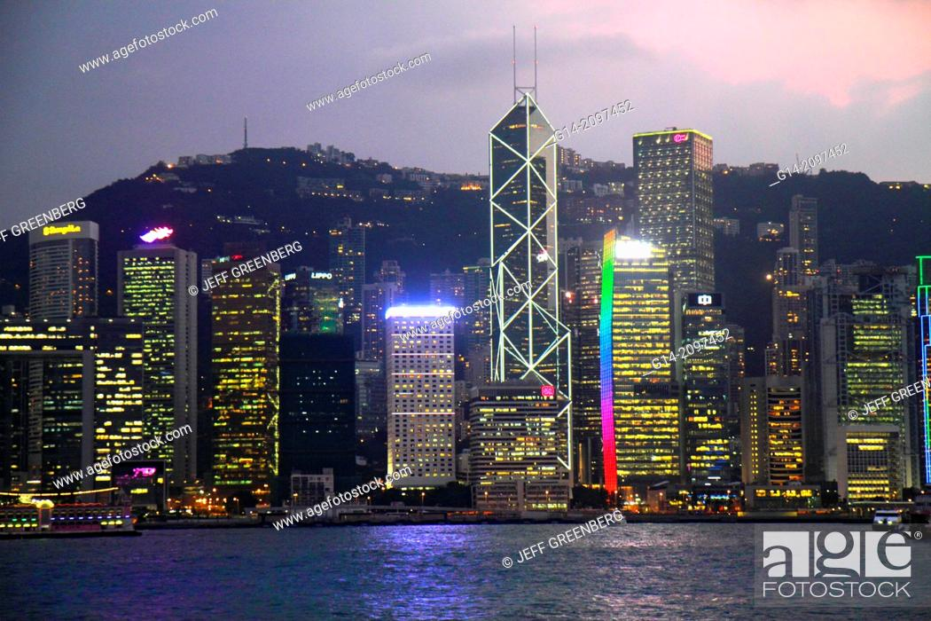 Stock Photo: China, Hong Kong, Kowloon, Tsim Sha Tsui, Kowloon Public Pier, view, Victoria Harbour, harbor, Island, city skyline, high rise skyscrapers, buildings, dusk.