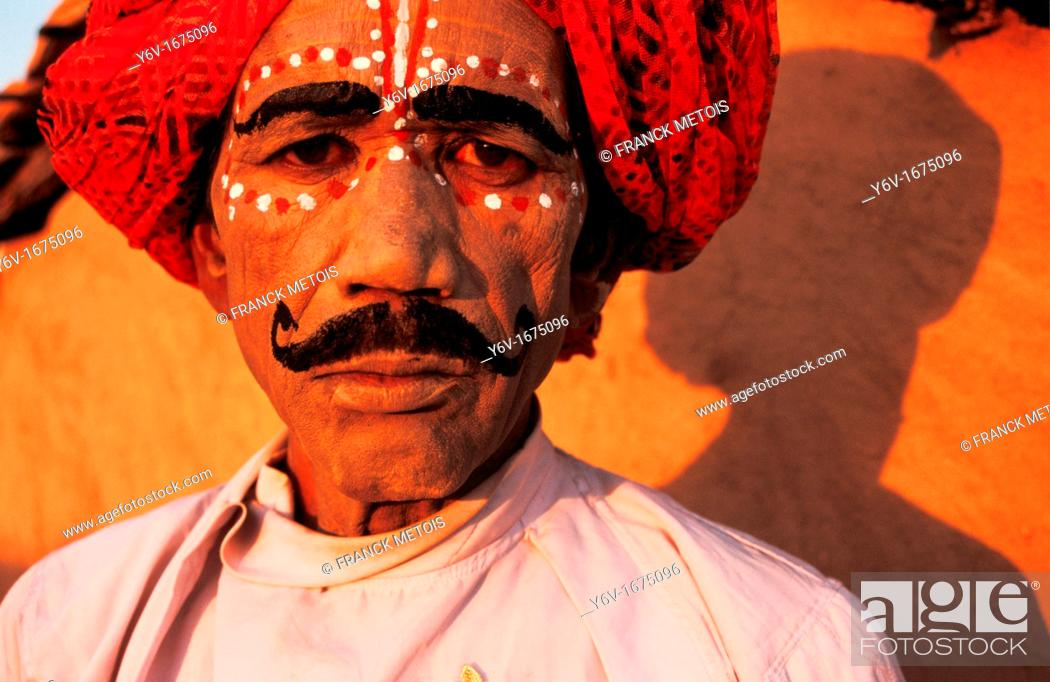 Stock Photo: Folk dancer before performing the Kachhi ghodi dance. From Rajasthan, India. The Kachhi ghodi dance can be translated in the horse dance in english.