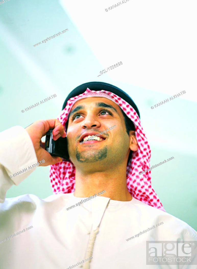 Stock Photo: Arab man using mobile phone.