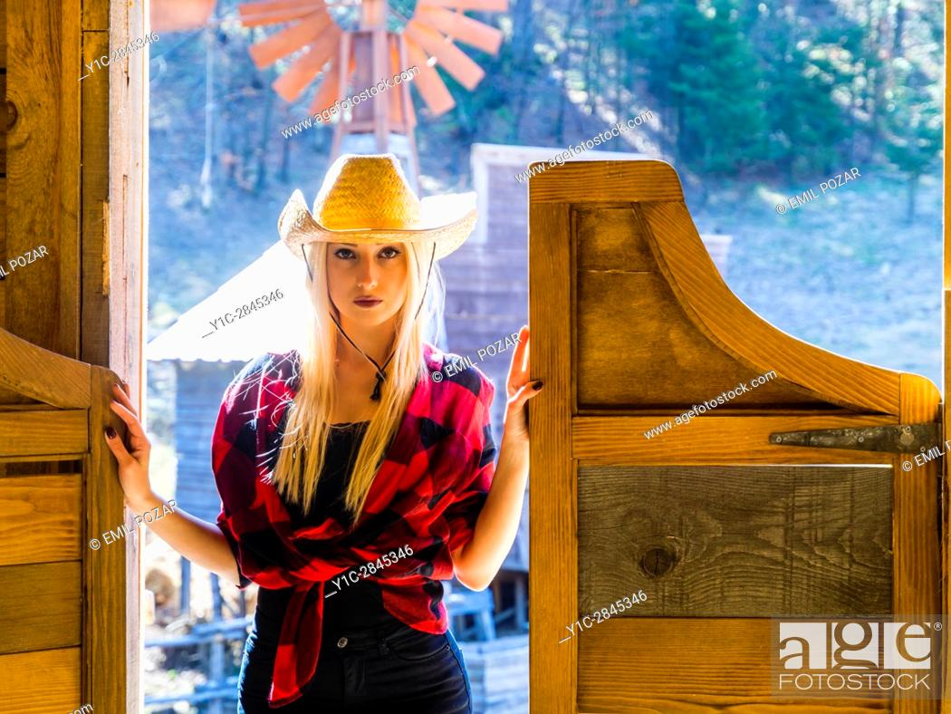 Stock Photo: Country-girl attractive beautiful blonde young woman.
