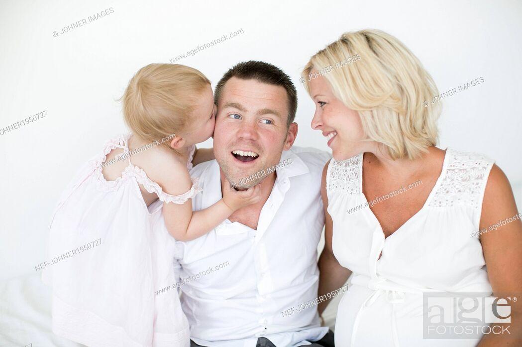 Stock Photo: Parents with daughter, studio shot.