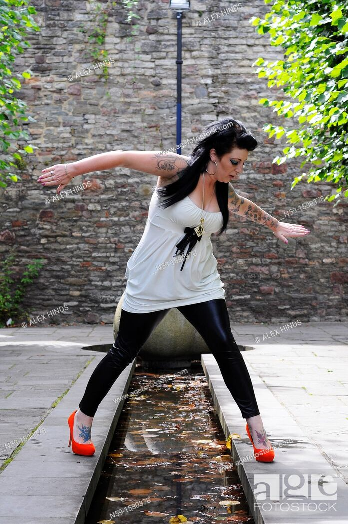 Stock Photo: Young tatooed alternative woman.