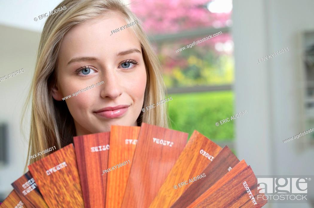 Stock Photo: Woman holding laminated boards.