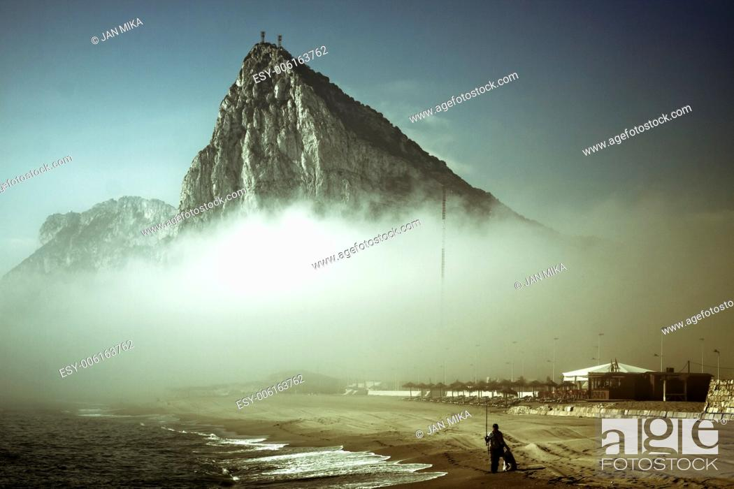 Stock Photo: The Rock of Gibraltar Abstract creative photo of Gibraltar Rock in foggy morning.