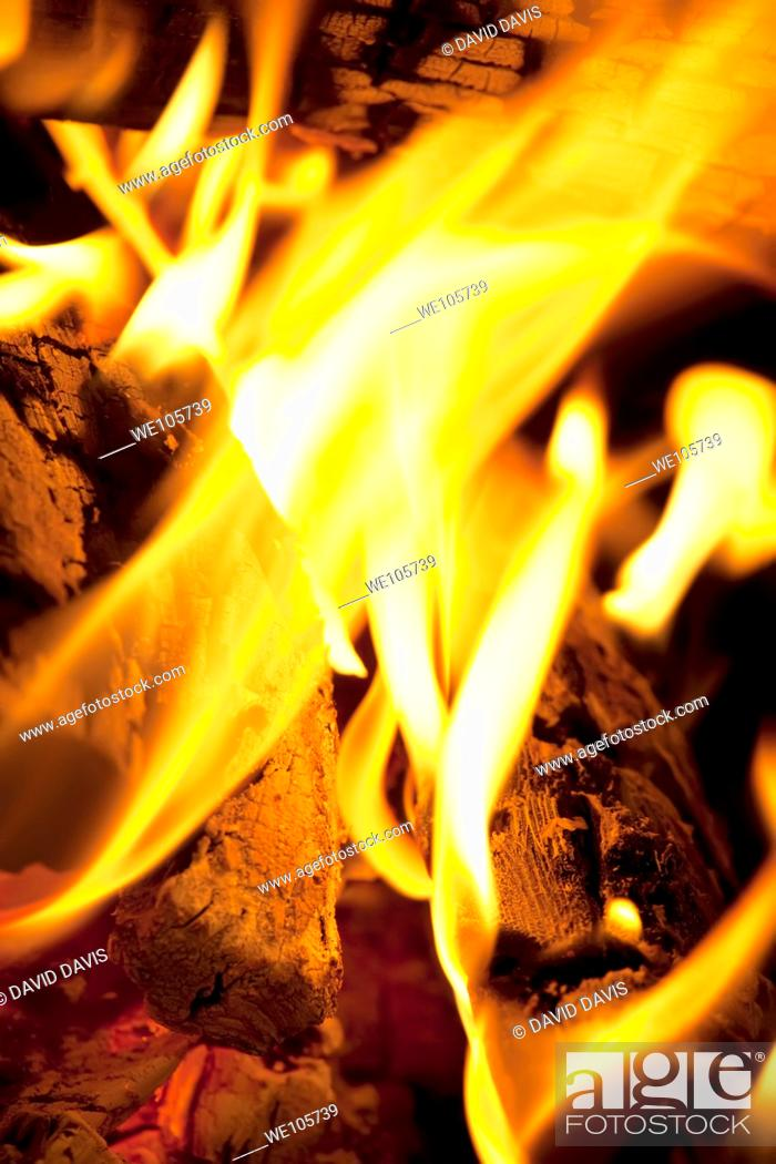 Stock Photo: Logs burning in an outdoor campfire.