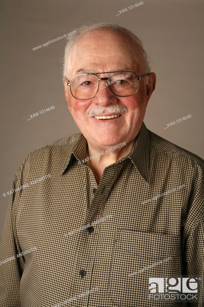 Stock Photo: A senior citizen man poses for a portrait.