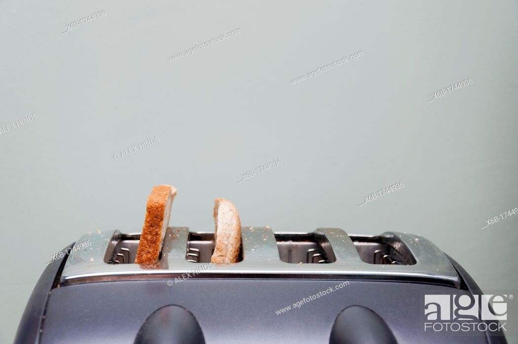 Stock Photo: Slices of bread in a toaster.