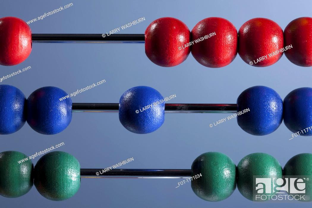 Stock Photo: The red, blue and green beads of an abacus, close-up.