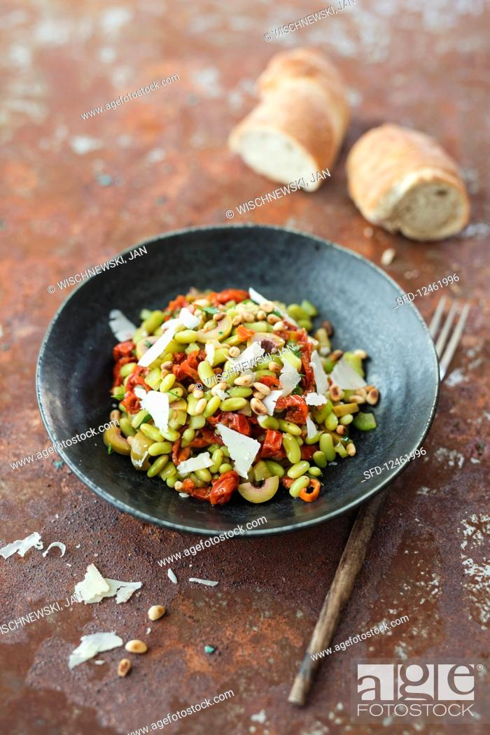Stock Photo: Salad with flageolette beans, olives, dried tomatoes and celery.