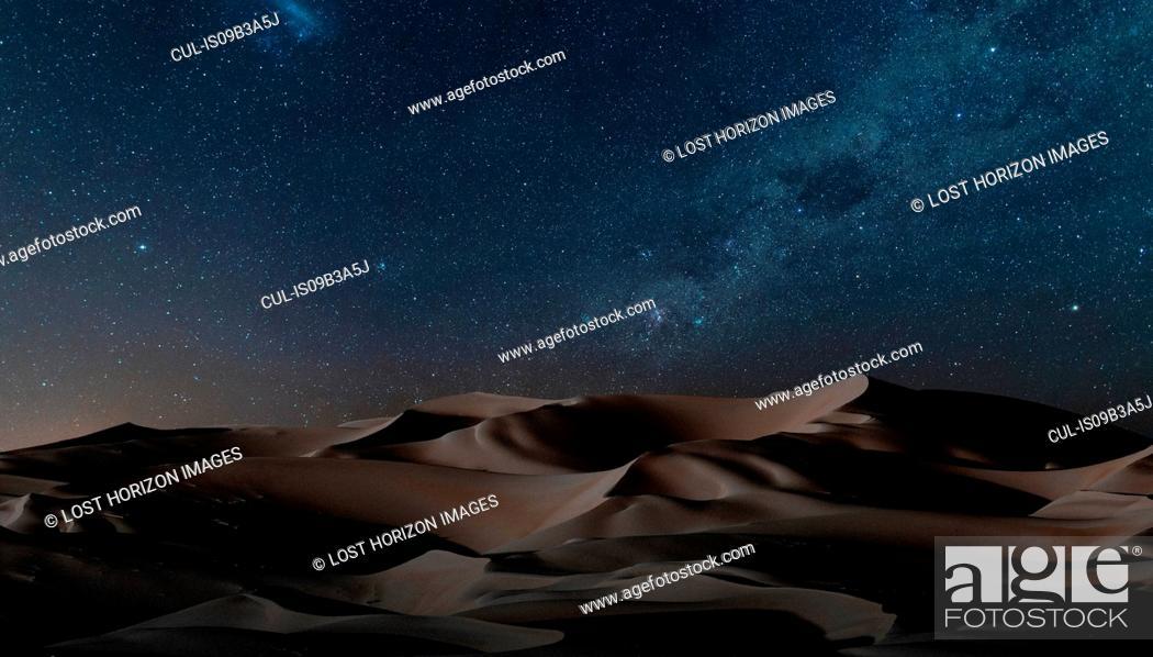Stock Photo: View of dunes under starry night sky, Namib Desert, Namibia.