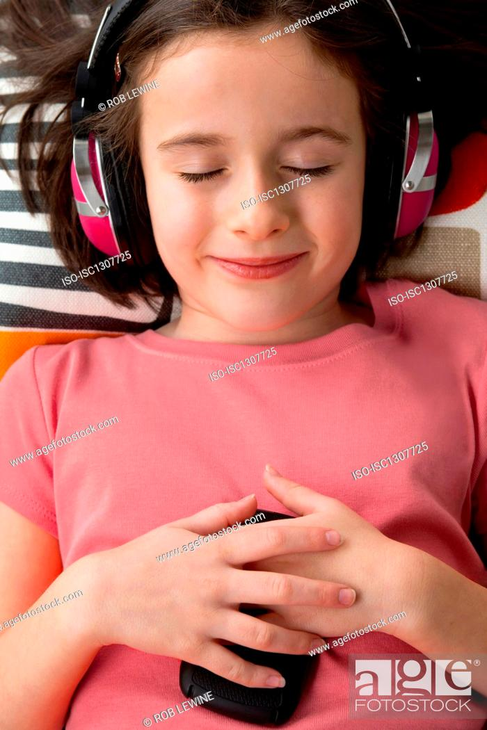 Stock Photo: Girl wearing headphones, eyes closed.