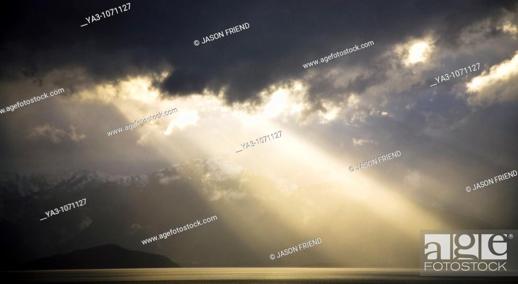 Stock Photo: New Zealand, Southland, Fiordland National Park  Dramatic light as a storm clears from the moutain peaks surrounding Lake Te Anau.