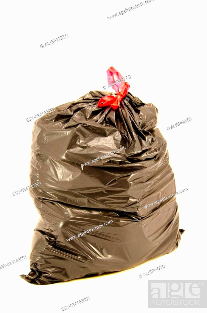 Stock Photo: isolated full black garbage plastic bag in white background. Rubbish sack.