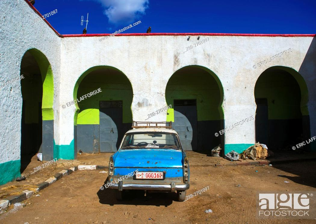 Stock Photo: Ethiopia, Harari Region, Harar, peugeot 404 taxi in the market of the old town.