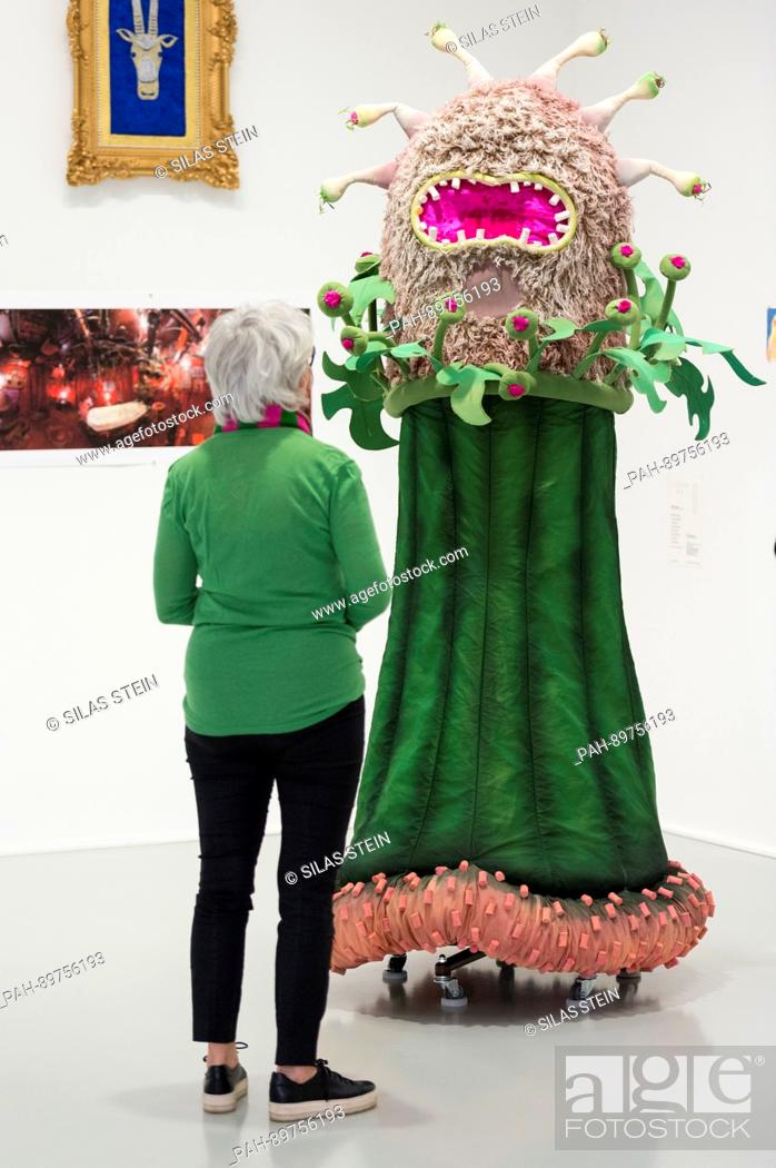 """Stock Photo: A visitor looks at a flower costume from the theatre piece """"""""Komm in meinen Wigwam"""""""" from the year 2014/15 at the Theatre Dortmund."""