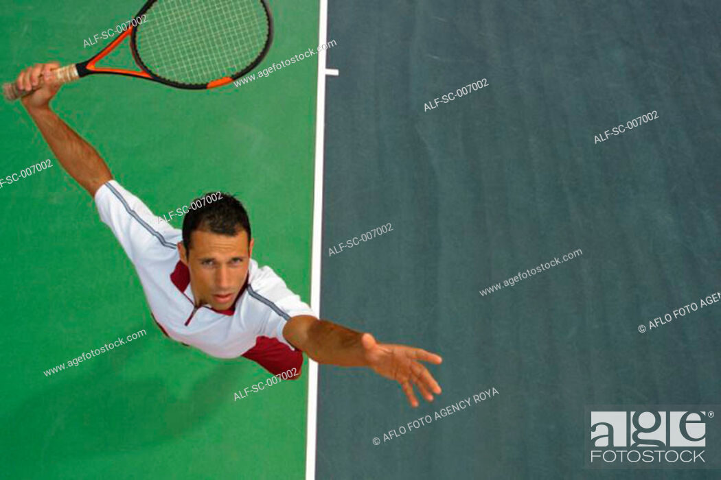 Stock Photo: Top View of Male Tennis Player Mid-Serve.
