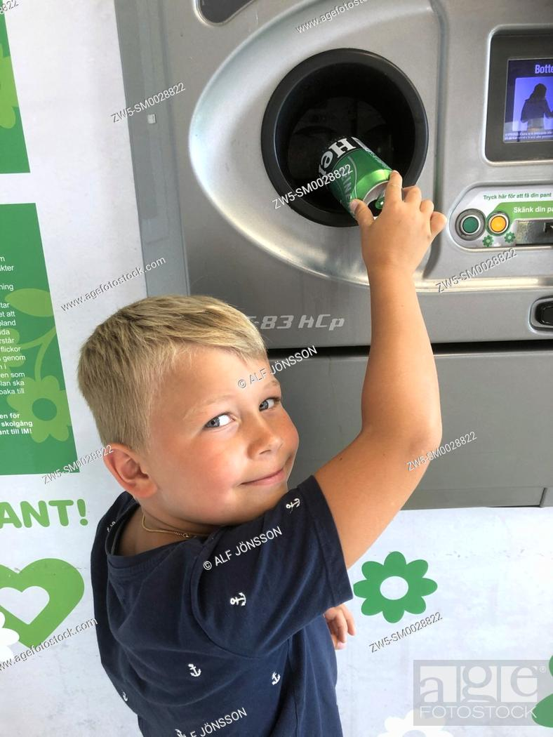 Stock Photo: Little blond boy, seven years old, recycling cans and earn pocket money in Ystad, Scania, Sweden, Scandinavia.