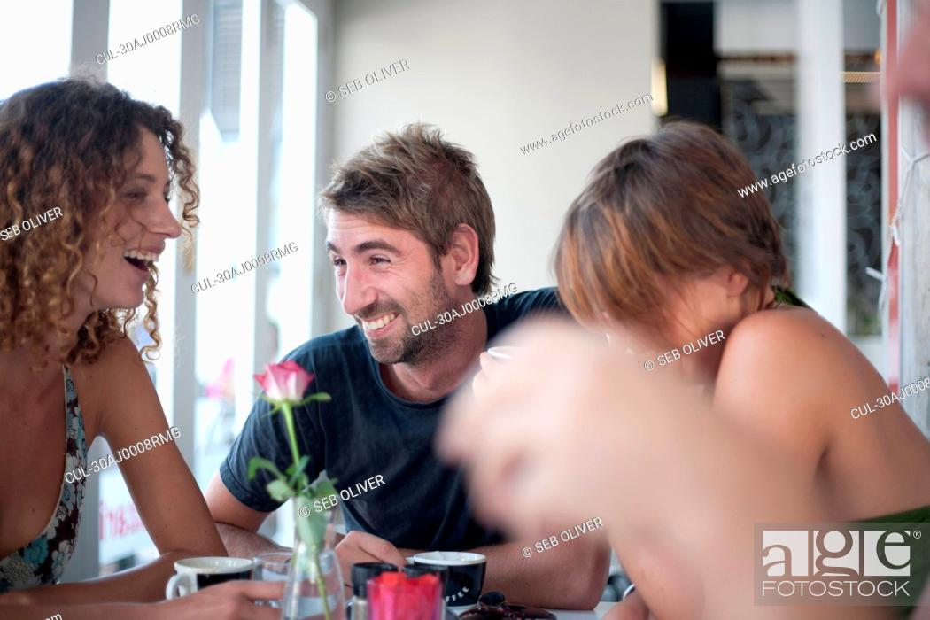 Stock Photo: Group of friends in restaurant.