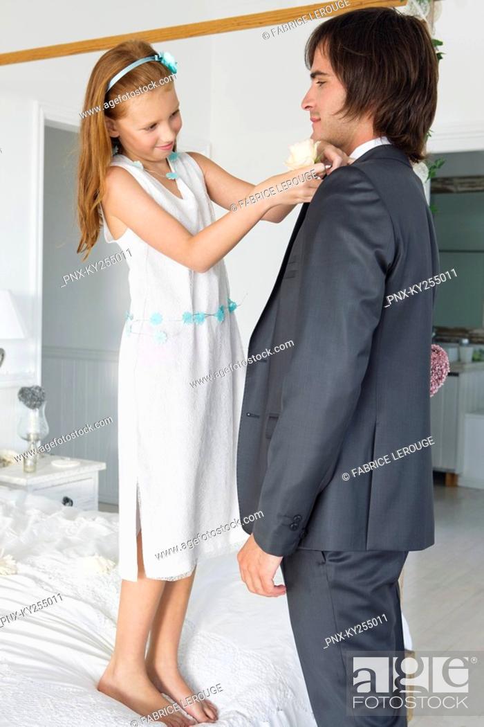 Stock Photo: Girl adjusting groom's tie.