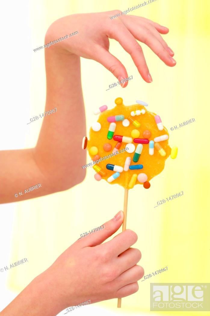 Stock Photo: Pills from an orange lollipop.