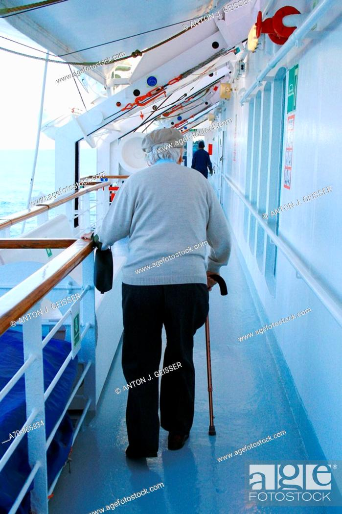 Stock Photo: Senior with going stick on cruise ship Coral, Louis Cruise LINEs.