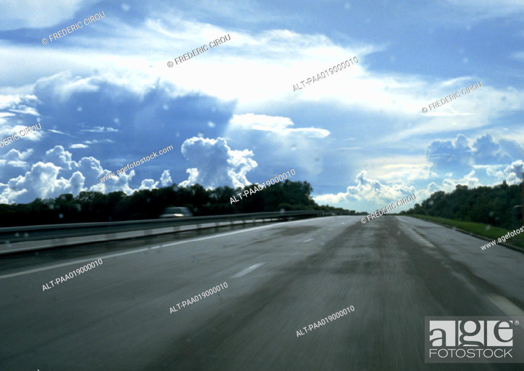 Stock Photo: Straight road, cloudy sky.