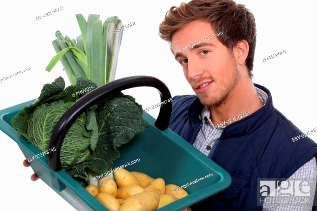 Stock Photo: portrait of a gardener with vegetables.