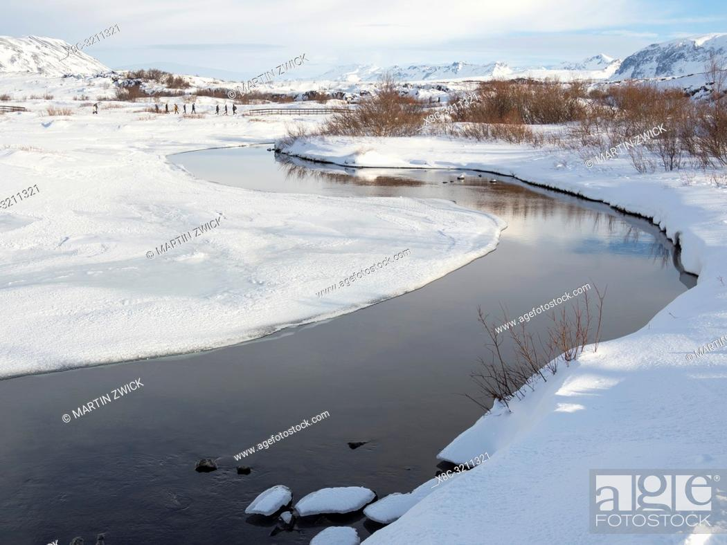 Stock Photo: River Oexara. Thingvellir National Park covered in fresh snow in Iceland during winter. Thingvellir is part of UNESCO world heritage.