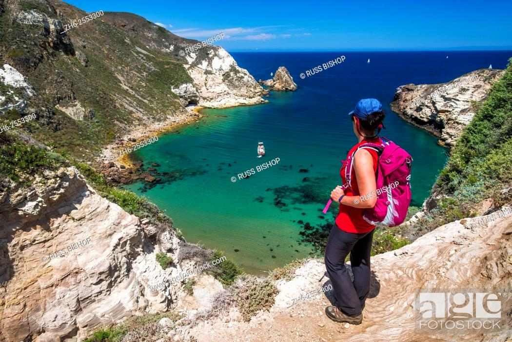 Stock Photo: Hiker at Potato Harbor, Santa Cruz Island, Channel Islands National Park, California.