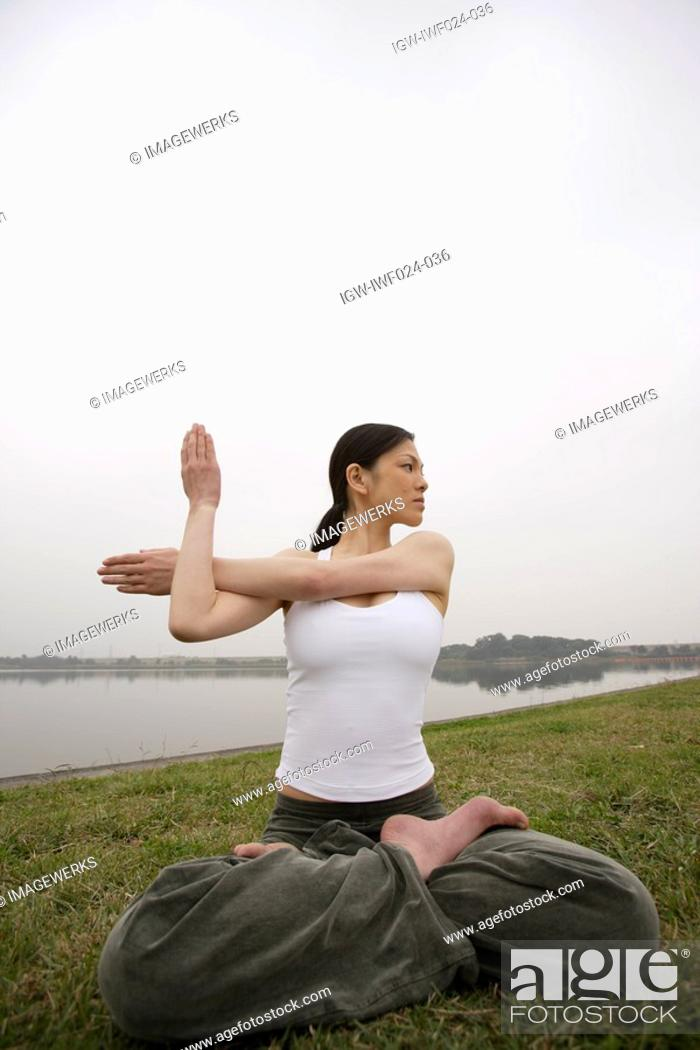 Stock Photo: View of a young woman practicing yoga.