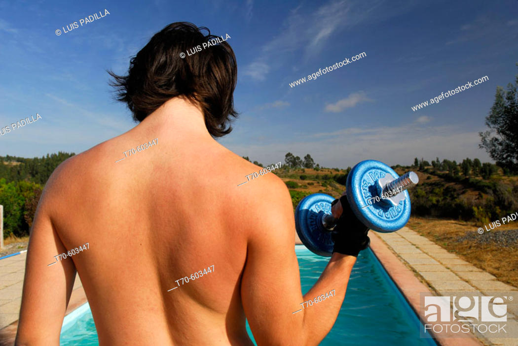 Stock Photo: Young man lifting weights. Chile.