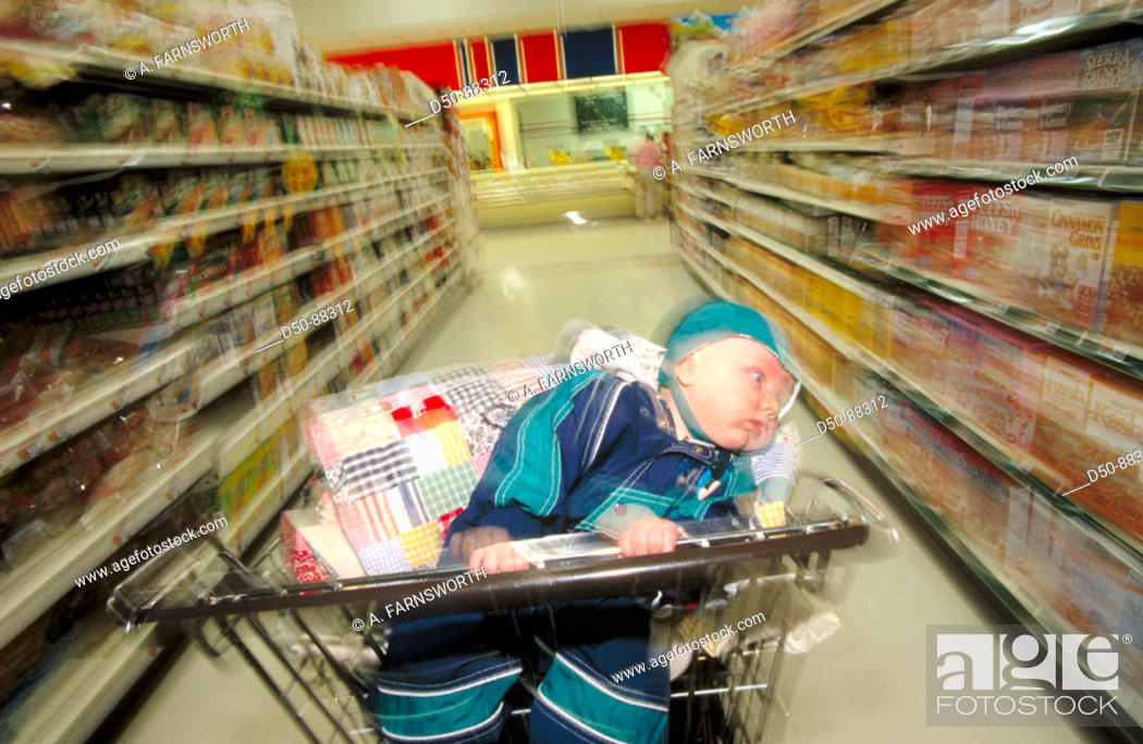 Stock Photo: Baby in shopping cart.