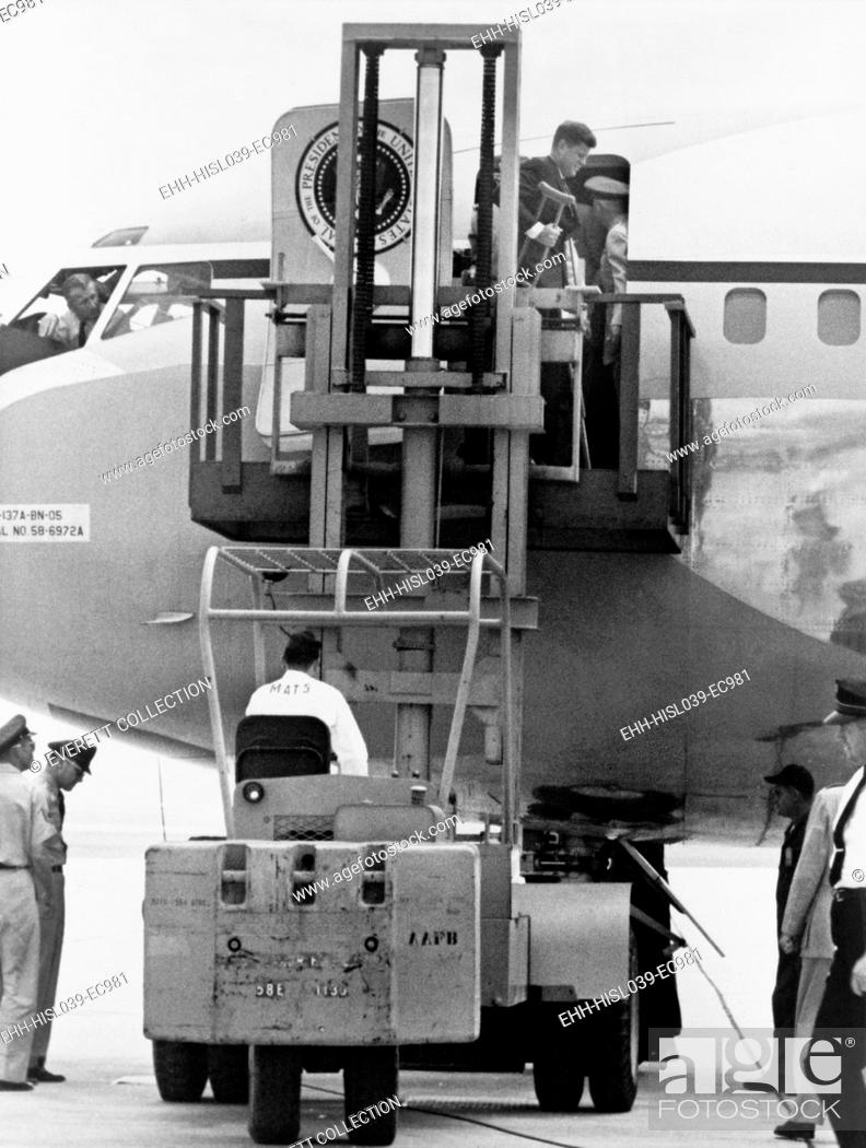 Stock Photo: President John F. Kennedy on crutches disembarking from Air Force One by fork lift. Kennedy injured his back planting a ceremonial tree during a state visit to.
