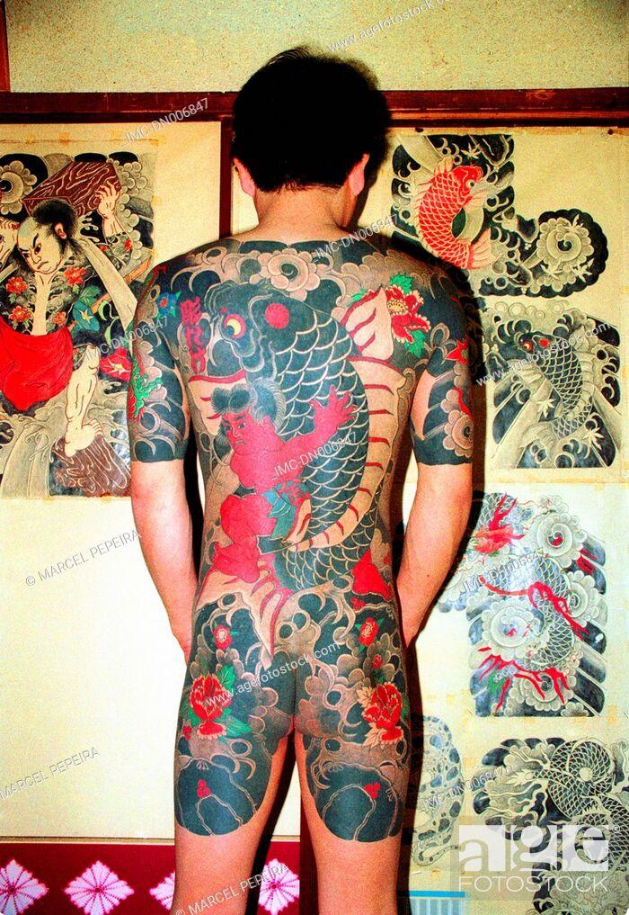 Stock Photo: Japan, Tokyo, tattoo studio, tattooed man.