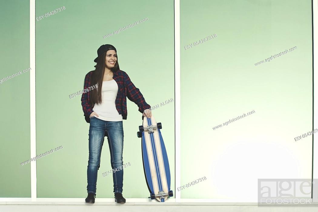 Stock Photo: Shot of beautiful female holding skate standing outside.