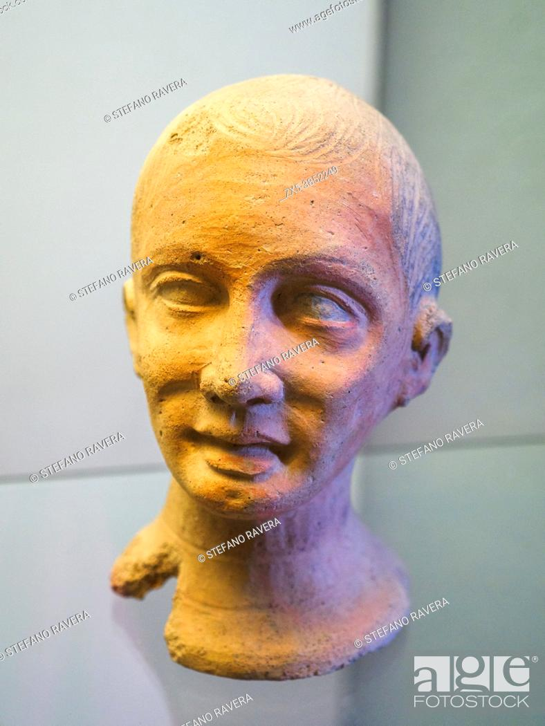 Stock Photo: Terracotta votive head at the altar of the queen (3rd cent. BC) - Tarquinia National Archaeological Museum, Italy.